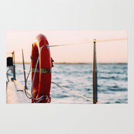 Red Life Buoy On Cruise Ship Rug