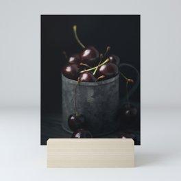 Ripe fresh cherry in a metal mug on a dark background Mini Art Print