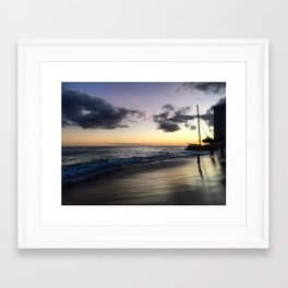 Waikiki Beach at Sunset With Silhouetted Boat and People Framed Art Print