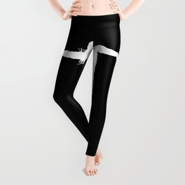 White silhouette of a female standing with the arms outstretched showing happiness - black background Leggings