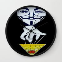 anonymous Wall Clocks featuring Anonymous by Edgar Huaracha