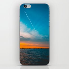 Beautiful sea in the afternoon with contrails in the sky iPhone Skin