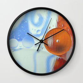 Oil bubbles in blue,orange and white Wall Clock