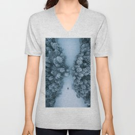 Man lying in the snow on a frozen lake in a winter forest - Landscape Photography Unisex V-Neck