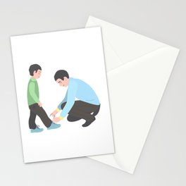 dad tying shoelaces to his son. A man with a little boy. Stationery Cards