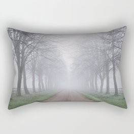 Avenue of trees beside a country road in fog. Norfolk; UK. Rectangular Pillow