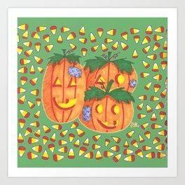 Halloween pumpkins and candy corn on green Art Print