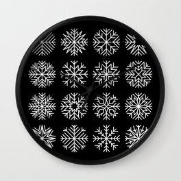 minimalist snow flakes on black Wall Clock