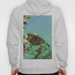 The butterfly collecting pollen on a flower Hoody