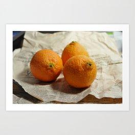 Oranges on newspaper Art Print
