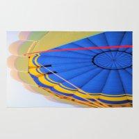 hot air balloon Area & Throw Rugs featuring Hot Air Balloon by Brian Raggatt