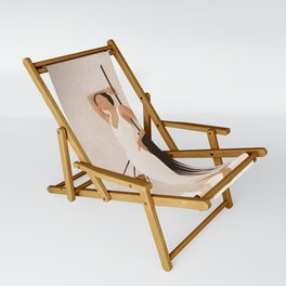 Minimal Woman with a Palm Leaf Sling Chair