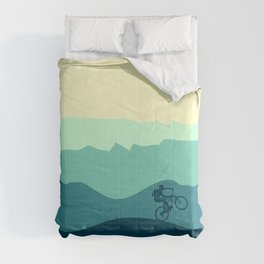 Mountain Biker cycling in the mountains  Comforters