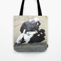 banksy Tote Bags featuring BANKSY  by Art Ground