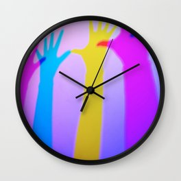 Colored silhouette shadow of hands Wall Clock