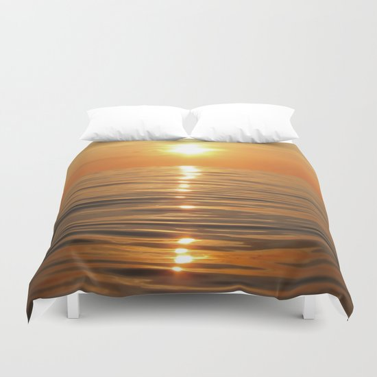 Sun setting over calm waters Duvet Cover