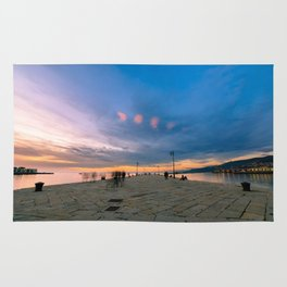 Colorful sunset in front of the city of Trieste Rug