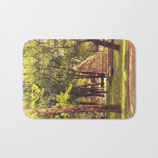 End of summer in park with trees and statue Bath Mat