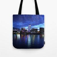 cincinnati Tote Bags featuring Cincinnati Skyline by  Rikki
