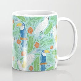 Blue toucan with white cockatoo amoung tropical flowers and leaves Coffee Mug