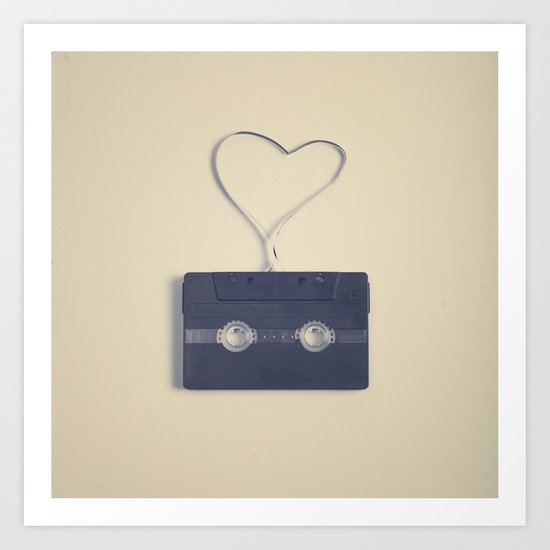 Retro black music cassette and heart shaped tape on beige background Art Print