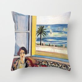 Seated Woman, Back Turned to the Open Window of Ocean & Seaside by Henri Matisse Throw Pillow