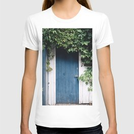 BLUE WOODEN DOOR SURROUNDED BY GREEN LEAVES AT DAYTIME T-shirt