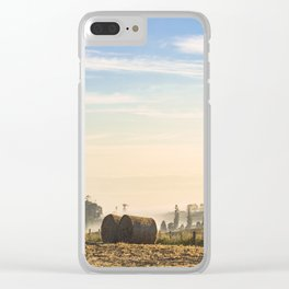 Hay bales in field at dawn Clear iPhone Case