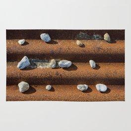 Pebbles on rust Rug