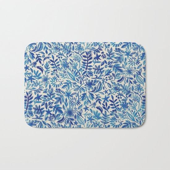 Floating Garden - a watercolor pattern in blue Bath Mat