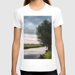 Green cottage at summer sunset T-shirt