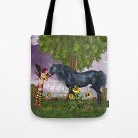 the last unicorn Tote Bags featuring The Last Black Unicorn by Simone Gatterwe