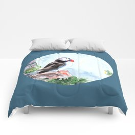 Puffin sitting on a rock with a blue background Comforters