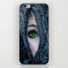 Big green eye in a blue tree iPhone Skin