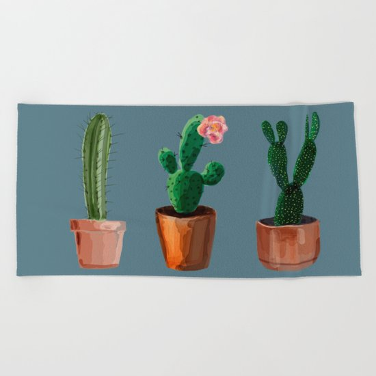 Three Cacti On Blue Background Beach Towel