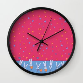 St. Valentine's Day Pattern. Pink pattern, on the blue field, white bunny hold blue and yellow heart Wall Clock