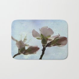 spring blooms on a bu background  Bath Mat