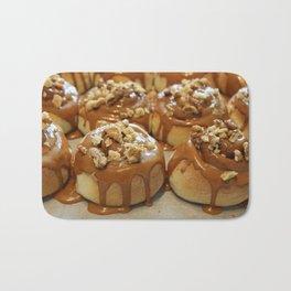 Homemade baking. Buns with caramel and walnuts. Bath Mat