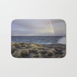 Rainbow on the sea Bath Mat
