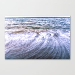 Waves and sand on the beach Canvas Print