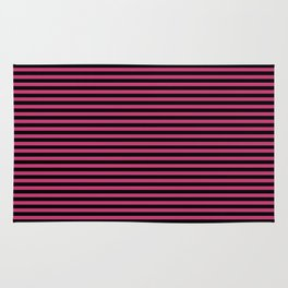 Across striped black and dusty pink background Rug
