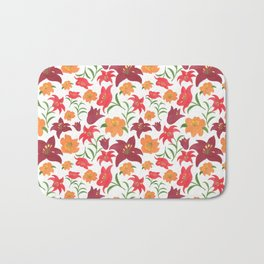 The Lilies in Red Bath Mat