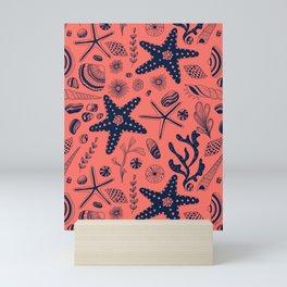 Sea shells on living coral background Mini Art Print
