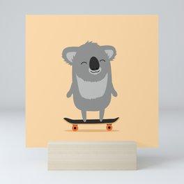 Cute cartoon koala skateboarding Mini Art Print