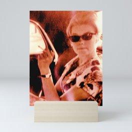 Lady on the backseat Mini Art Print