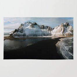 Aerial of a black beach at the ocean with Mountain in south Iceland during sunset - Landscape Photog Rug