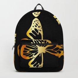 Golden butterflies flying against black Backpack