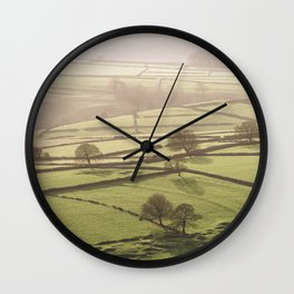 Hazy light at sunset over a valley of fields. Derbyshire, UK. Wall Clock