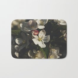 Moody crabapple blossoms Bath Mat