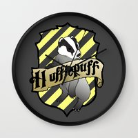 hufflepuff Wall Clocks featuring Hufflepuff Crest by AriesNamarie